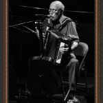 Alan Reid playing accordian